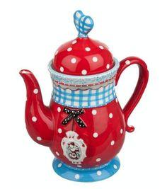 met deze mooi thee pot en goed boek op de bank
