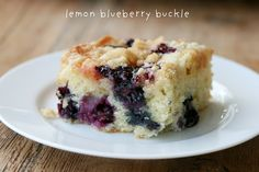 """This Lemon blueberry buckle appeared in the Los Angeles Times Food Section in May 2009. It is adapted from """"Rustic Fruit Desserts"""" by Cory Schreiber and Julie Richardson. This is a fruit cake, crumb topping and a lemon glaze on top. Oh yes, crumb topping with lemon glaze. Deliciousness."""