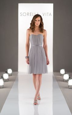 Strapless cocktail gown featuring a pleated tulle bodice, and soft flowy skirt.
