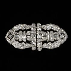 Double-clip brooch. Place of origin: England (probably, made).  Date: ca. 1930-1940 (made).  Artist/Maker: Unknown (production).  Materials and Techniques: Platinum set with brilliant, baguette and square-cut diamonds.