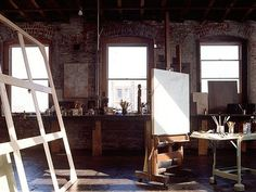 The painting studio retains the original industrial asphalt floor. The light is incredible!