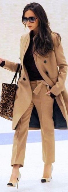 Victoria Beckham's Camel coat, Leopard handbag, Black sunglasses, and Cap toe pumps.