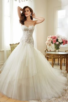An asymmetrical waist is an excellent slimming trick because it runs on the diagonal.Gown by Sophia Tolli.