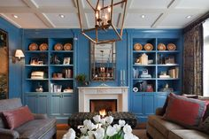 Blue Paisley Living Room With Built-In Bookshelves
