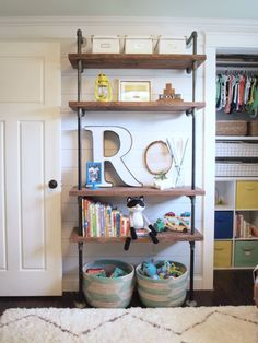 "If you spend any time reading DIY and decorating blogs -- or ""building"" a dream home on Pinterest, like I do -- you have no doubt seen a slew of industrial pipe shelving projects.  They're quite popular recently.  I absolutely love the look and I knew the first time I saw a pipe shelving unit that I was going to build one in my boys' bedroom someday.  I will share with you some of the things we learned along the way."