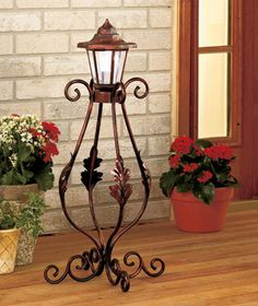 Add a classic touch of scrollwork to your home or patio decor with the teardrop-shaped Solar Garden Post. The lantern at the top is solar-powered, so it needs no time-consuming installation. Glows with constant white light for up to 8 hours on a