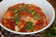 A Deep South Courtbouillon is a roux-based fish stew, made with creole tomato sauce, stewed down and reduced, and used to poach fish - often redfish, red snapper or catfish.