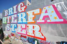 Brighter Faster -- street art by Ben Eine