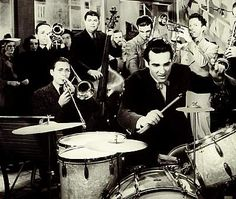 Gene Krupa...one of the best drummers from the bigband era...living wildly in a wild time...awesome;}