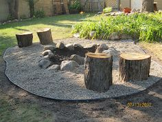 DIY fire pit, I really like the tree stumps as chairs :) and other inspiring gardening bits