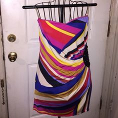 Multi colored strapless blouse #girlsnightout Multi colored strapless blouse comes with padded bra on the inside and black beading on the left side of the waist . You can pair this with shorts or jeans . Accessorize it with a red or black clutch bag , black earrings and black bangles . Trac Tops Blouses