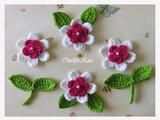 This listing you will receives 10 pieces of crochet applique.  4 flowers 2D 4 cm=1.6 inches White with  Lightpink  Colors with white small perls 4 leaves 4 cm AppleGreen 2 leaves with stem 4cm...