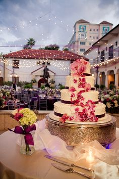 #WeddingWorld White wedding cake with a magenta ribbon lace and detailed with pink and burgundy orchid flowers   stunning #WeddingCakes