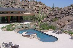 Surrounded by natural boulders and native plantings, this award-winning freeform pool resembles a desert waterhole. Its crystal blue water a refreshing site amid the miles and miles of arid landscape. Cimarron Circle Construction, Tuscan, Arizona (2012 Aquatech® Awards) http://www.poolspaoutdoor.com/photos/2012-aquatech-award-winning-pools.aspx