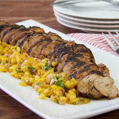Chili-rubbed pork tenderloin gets a flavorful crust when cooked on the grill. Top with a mango salsa for a delectable summertime dinner on the patio.