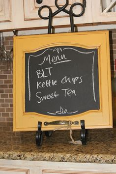 Great idea ... a cabinet door chalkboard using chalkboard paint.