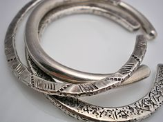 These are one-of-a-kind designed and crafted by Linda Summers, Jeweler and Silversmith. They are designed to wear together and even with the Twisted Sterling Bracelet. They are stunning in their simplicity.