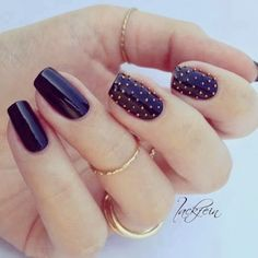 I LOVE black nails and these small gold studs make it even better.