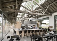Bedaux de Brouwer converted an old train station into a beautiful office and restaurant in Tilburg, the Netherlands. Office Interior Design, Office Interiors, Interior Decorating, Office Designs, Industrial Sheds, Industrial Chic, Industrial Lighting, Industrial Design, Shed Office