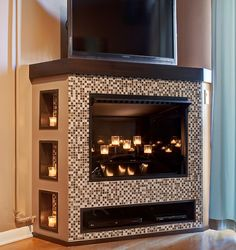 This herringbone tile fireplace looks so cool and modern popham