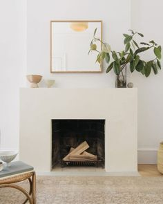 Clever Ways to Finally Upgrade An Old Worn Down or Dated Fireplace minimalist fireplace idea with simple fireplace surround Simple Fireplace, Interior, Home, Fireplace Design, Living Room Decor, Minimalist Fireplace, House Interior, Trending Decor, Modern Fireplace