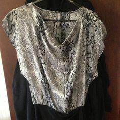??Snake Print Top?? Snake print top! Very sexy feels silky smooth pair with a skirt or a jeans Tops