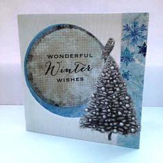 A 12x 12cm card with a die-cut aperture, created by Nicky Gilburt for Craftwork Cards using Frozen Forest collection