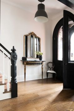black doors and stair railing // Christine Dovey