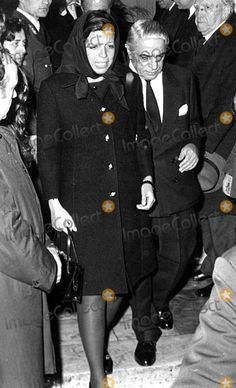 Christina Onassis with her father Aristotle Onassis at the funeral of Alexander Onassis, 1973.