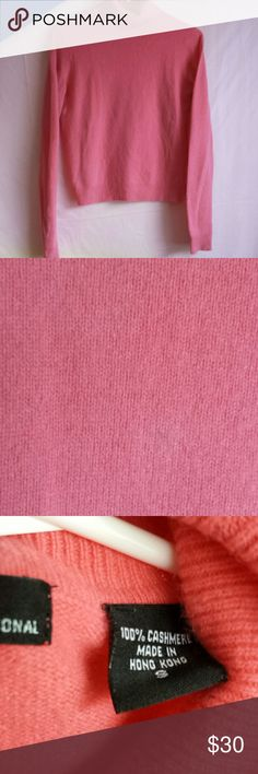 """Pink 100% Cashmere Turtleneck Sweater One must have cashmere for the Winter.  This pink 100% cashmere turtleneck sweater is what the sweater girl in you ordered.  There is a subtle mark on the chest (in pic) that isn't conspicuous and no holes.  Visible wrinkles are from being folded in drawer. Moda International Label says Small & measures as such, 16.75"""" armpit to armpit and 22"""" long. Moda International Sweaters Cowl & Turtlenecks"""