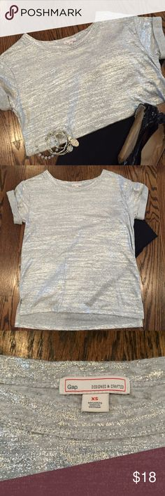✨New listing✨ Silver Gap tee This silver foiled Gap tee is daytime comfort combined with nightlife fun.  It is soft cotton on the inside with fun & funky silver on the outside.  It is a longer tee and looks great over leggings!  Only wore it once - in excellent used condition.  Size XS. GAP Tops Tees - Short Sleeve
