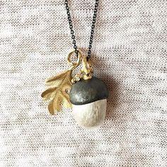 Acorn pendant in sterling silver, 18k gold and 1 bril. €745.  Leaf pendant in 18k gold €895.  Close-up shot by @gullsmedneerbye  #silveredition #sterlingsilver #acorn #oxidizedsilver #18kgold #olelynggaard #olelynggaardcopenhagen #design #charlottelynggaard @charlottelynggaard_dk