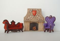 """A scene featuring some of the minature furniture I have made. They are 1/4"""" = 1' scale. I work with two part epoxy mostly, and sometime with polymer clay as well."""