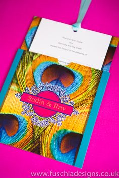 This stunning Asian wedding invitation has been designed with a peacock design and ethnic style motif. This Asian wallet invitation comes complete with matching coloured ribbon. We can create this design in any colour of your choice and personalised if required with religious symbols. This design is also great for Asian mehndi celebrations and parties. From www.fuschiadesigns.co.uk