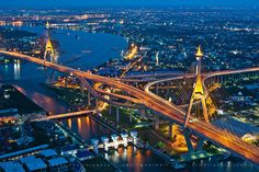 Bhumibol Bridge (also known as the Industrial Ring Road Bridge or Mega Bridge) in Bangkok, Thailand;  the bridge crosses the Chao Phraya River twice, with two cable-stayed spans of lengths of 2,303 feet and 1,909 feet supported by two diamond-shaped pylons 568 feet and 538 feet high. Where the two spans meet, another road rises to join them at a free-flowing interchange suspended 164 feet above the ground;  info from Wikipedia;  photo by joeziz EK pholrojpanya, via Flickr