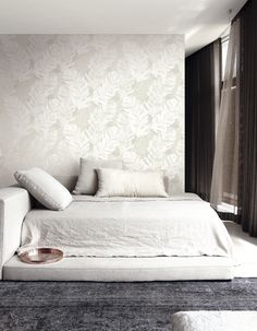 Relaxing linen bedroom with floating feathers from Wallquest's White on White Collection