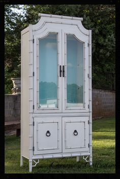 """This vintage faux bamboo cabinet by Thomasville has been made new again in our most popular """"Antiqued Cream"""" finish. I love the Aqua in the back!"""