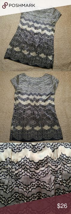 CAbi Faux Chantilly Lace Silk Cap Sleeve Tunic Top CAbi 100% silk cap sleeve top has a rounded and pleated neckline, vented hem, and gatherings under bust and in the back for a flattering fit. Patterned to give the illusion of chantilly lace. Black, gray and taupe. Size medium. Hand wash. Very gently used and in excellent condition with no flaws. See photos for details. CAbi style #817. Approximate measurements Armpit to armpit 18 Shoulder to hem 26  CATEGORY CAbi Tops Blouses