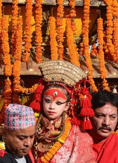 """A young Nepalese girl revered as the living goddess """"Kumari"""" is carried to the golden chariot on the main day of the Hindu Indra Jatra festival at Basantapur Durbar Square in Kathmandu. The week-long festival celebrates Indra, the king of gods and the god of rains, when the Kumari living goddess is carried in a palanquin during a religious procession through parts of the Nepalese capital. (Prakash Mathema/AFP/Getty Images)"""