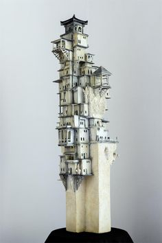 Wim Jonker mixed media; love the town seeming to grow out of the pillar