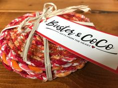 Boho coasters, fabric twisted twine, hand twisted, cotton, homeware, coaster set. Beautiful colours, soft and sturdy, protects and won't scratch the furniture, hand twisted fabric twine coasters. A set of 4 coasters. Colours – oranges and reds. Each coaster unique, but matching. Be
