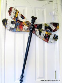 Lucy Designs: Graffiti and Giraffe Spindle Dragonfly and Butterfly.  Lots of upcycled crafts on this site.