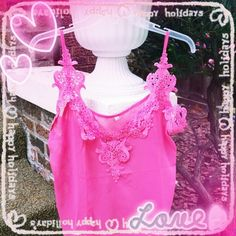 HPPretty in Pink Lace Sheer Tank Top Beautiful sexy and romantic tank tops This is pretty in pink neckline & sheer  bottom!   ImportantSizes run two sizes smaller from China !    This listing is for an tag size XXXL but fits like a XL/XXL!   RUNS SMALL        In photo I'm wearing an XXXL and I'm usually an XXL it looks good on top but it snug in stomach and shorter then I like in back! Great quality very pretty sexy and beautiful ! XXXL tag size   Length 23 inches  Bust 43 inches accross…