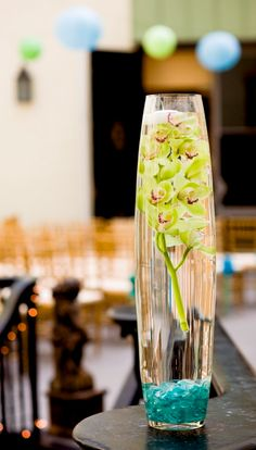 Our Aqua beads with green cymbidium orchids - photo by Jennifer Hughes