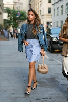 Entrepreneur Miroslava Duma wears a denim jacket sweater/shirtdress top and a Gabriela Hearst bag at the Thakoon show on September 8 2016 in New York...