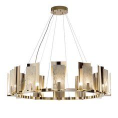 This magnificent chandelier will be an elegant and sophisticated focal point in a contemporary room, displayed above a dining table, a staircase, or even in a minimalist living room. A superb showcase of craftsmanship, it is composed of 12 shades made of gold-finished brass and white Carrara marble, each containing a G9 LED lightbulb that enhances the charming quality of the natural veining of marble. Mounted on a circular gold-finished brass structure, it is also available in other finishes… Glass Chandelier, Chandelier Lighting, Pendant Lamp, Chandeliers, Ceiling Lamp, Ceiling Lights, G9 Led, Venetian Glass, Carrara Marble