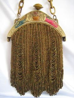 """Art Deco Celluloid Frame Beaded Swag Purse Figural Maidens Flowers.The celluloid frame is a rare figural with four maidens (two on each side) each looking at an urn full of flowers. The body of the purse is made of swagged, bronze colored, carnival glass beads. There is a carved celluloid rose which is the """"push"""" opener for the purse."""