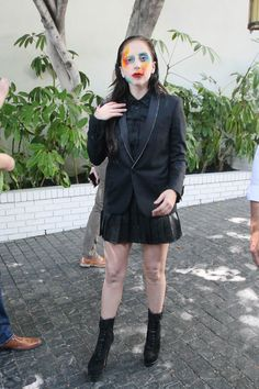 Lady Gaga leaving her hotel in West Hollywood wearing ARTPOP face paint