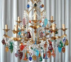 A beautiful 9 arm fruit chandelier with a golden frame and mixed multicoloured solid glass fruit. Dimensions:Diameter : : (excluding chain) Power : 9 x (max Bulb. Shipping CategoryCategory A Painted Chandelier, Murano Chandelier, Italian Chandelier, Italian Lighting, Ceiling Chandelier, Chandeliers, Beaded Curtains, Murano Glass, Pendant Lighting