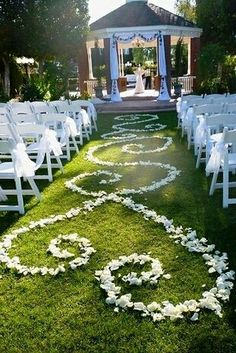 Bride & Groom Initials with rose petals down the isle.